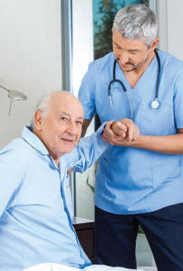 male nurse with elderly male patient